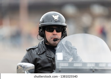 St. Louis, Missouri, USA - March 2, 2019: Bud Light Grand Parade, Police officer from the St. Louis P.D. Motor Squad riding down 7th Street