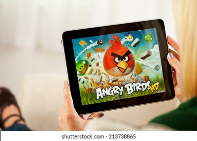 St. Louis, Missouri, USA - March 9, 2011: Woman Playing Angry Birds Video Game On Apple iPad 1