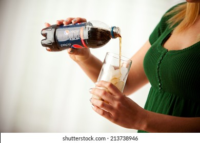 St. Louis, Missouri, USA - March 9, 2011: Woman Pouring Pepsi Soda Into Glass Of Ice