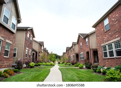 St. Louis, Missouri, USA, Sept. 2, 2020 - Row of houses close together residential suburban home development, brick homes, congested crowded housing, similar looking homes, construction