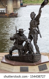 ST. LOUIS, MISSOURI,USA-SEPTEMBER 15, 2013: The Captain's return sits on the waterfront in St. Louis on September 15, 2013. The statue was dedicated in 2006 and sits in the shadow of the Arch.