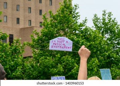St. Louis, MO / United States 05/21/2019: A wire hanger protest sign at the NARAL Rally for abortion rights in downtown St. Louis, MO