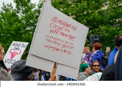 St. Louis, MO/United States 05/21/2019: A protest sign and activists at the NARAL rally for abortion right s in downtown St. Louis, MO