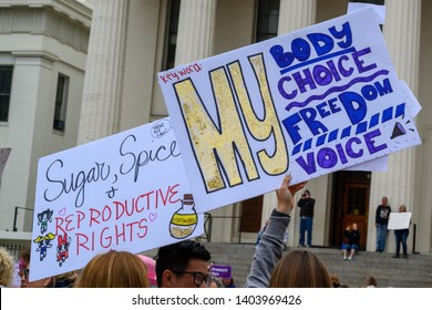 St. Louis, MO/United States 05/21/2019: Activists take to the streets in front of The Old Courthouse in downtown St. Louis, MO at the NARAL Rally For Abortion Rights.