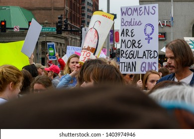 St. Louis, MO/United States 05/21/2019: Activists rally with protest signs for the NARAL Rally for Abortion Rights in downtown St. Louis, MO