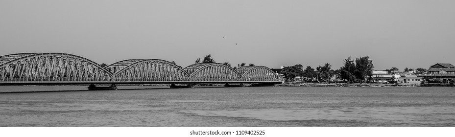 St Louis, Senegal - October 14, 2013: Black and white panorama of Faidherbe Bridge spanning Senegal River opened in 1897