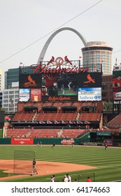 ST. LOUIS - SEPTEMBER 18: The Cardinals scoreboard and the Gateway Arch are seen from Busch Stadium before a game between the Cardinals and Padres, on September 18, 2010 in St. Louis.