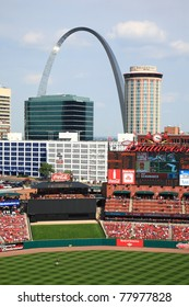 ST. LOUIS - SEPTEMBER 18: The Cardinals scoreboard and the Gateway Arch are seen from Busch Stadium before a game between the Cardinals and Padres, on September 18, 2010 in St. Louis, MO