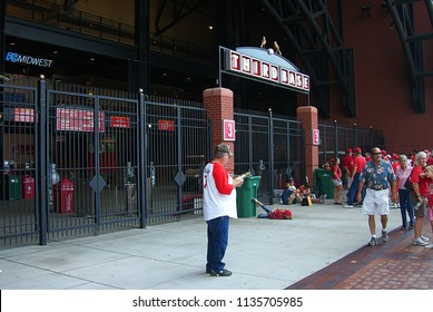 ST. LOUIS - SEPTEMBER 18: Unidentified fans wait for baseball outside Busch Stadium, home of the Cardinals, on September 18, 2010 in St. Louis. Opened in 2006, it seats 43,975 and cost $365 million.