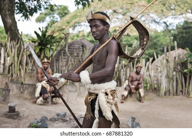 St. Lucia- South Africa - June 25, 2017: Zulu warrior in traditional dress in Khula Zulu Village in the near of Santa Lucia in South Africa