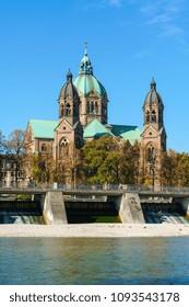 St. Luke Church near Isar river and Wehrsteg bridge, Munich, Germany