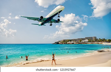 St Maarten, Netherlands - February 13, 2016: beach observe low flying airplanes landing near Maho Beach on island of St Maarten in the Caribbean