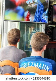 ST MALO, FRANCE - JULY 15, 2018. Unidentified French football fans supporters at France in front of the tv, during the final match of FIFA World Cup Russia 2018 France vs Croatia.