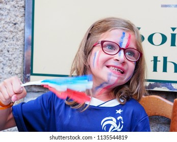 ST MALO, FRANCE - JULY 15, 2018. Unidentified French football little pretty girl fans supporters at France in front of the tv, during the final match of FIFA World Cup Russia 2018 France vs Croatia.