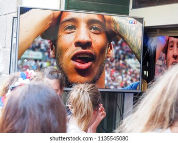ST MALO, FRANCE - JULY 15, 2018. Unidentified French football fans supporters at France in front of the tv, during the final match of FIFA World Cup Russia 2018 France vs Croatia. France won 4-2