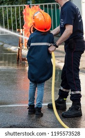 St Marie aux Mines - France - 2 October 2018 - closeup of french rescue man with child demonstration