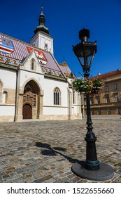 St. Mark's Church in Zagreb, croatia, with an ornamental gas lamp.
