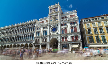 St Mark's Clock tower timelapse on Piazza San Marco, facade, Venice, Italy. Tourists on the square. On the facade of the tower is the astronomical clock, Lion of Saint Mark and Madonna with Child. At