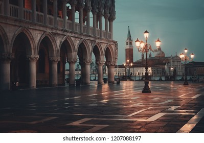 St Marks square at night with historical architectures and San Giorgio Maggiore church in Italy.
