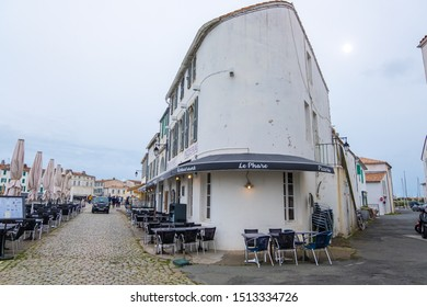 St Martin De Re, France - May 09, 2019: Restaurant tables in the old harbor of Saint Martin de Re on Ile de Re island, France