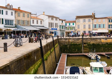 St Martin De Re, France - May 09, 2019: Harbour and quayside at La Flotte on Ile de Re island. It is one of the most beautiful villages in France