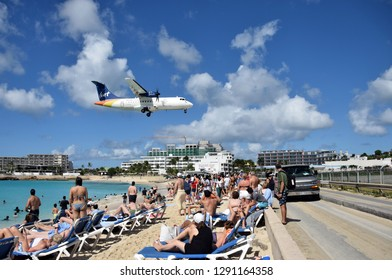 St Martin, Dutch Antelles - December 25, 2018: Airplanes land low over Maho Beach, St martin. the destination is a major tourist attraction of the island.