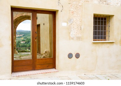 St. Martin gate in the old town of Magliano in Toscana, Italy