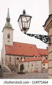 St. Martin's Cathedral (slovak: Katedrala svateho Martina) in Old Town of Bratislava, Slovakia. ancient street lantern in front.