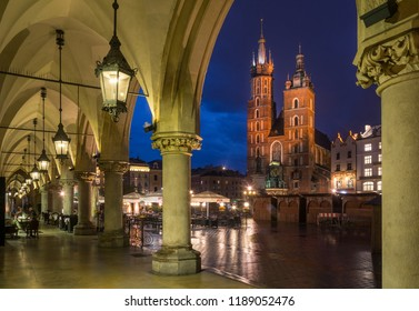 St. Mary's Basilica Catholic Church and the chandelier taken from the Cloth Hall in night time, 9th May 2018, Krakow, Poland