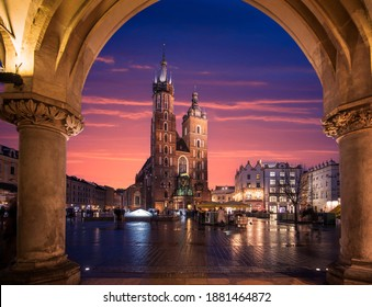 St Mary's Basilica (Mariacki Church) in the Old Town of Krakow (Cracow), Poland. Illuminated on The Main Market Square at night after sunset