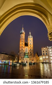 St. Mary's Basilica at night in Krakow, Poland, arch above Gothic church from 1347 at the Old Town Main Market Square