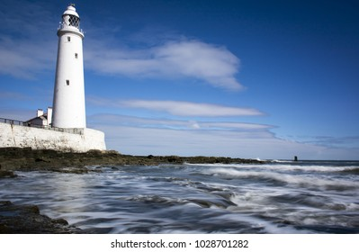 St Mary's Lighthouse, Whitley Bay, England on sunny summer day with motion blur waves