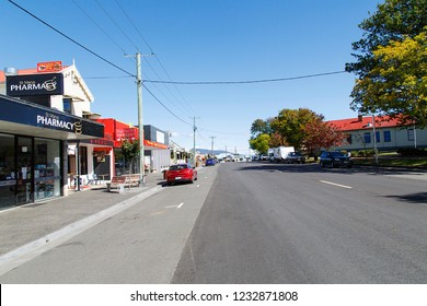 St Marys, Tasmania, Australia: March 30, 2018: Street view of St Marys town in Tasmania with local shops, a pharmacy and parked cars.