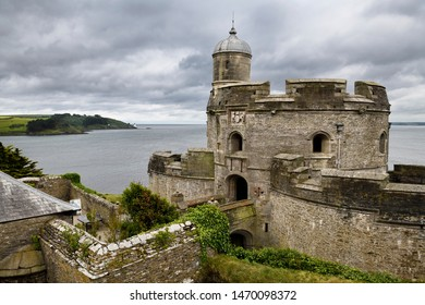 St Mawes Castle fortress looking to St Andrews Lighthouse on the coast of Carrick Roads and the Atlantic Ocean in Roseland Peninsula St Mawes, Cornwall, England - June 11, 2019