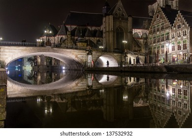 St Michael's Bridge in Ghent, Belgium at night, reflected in the Leie canal