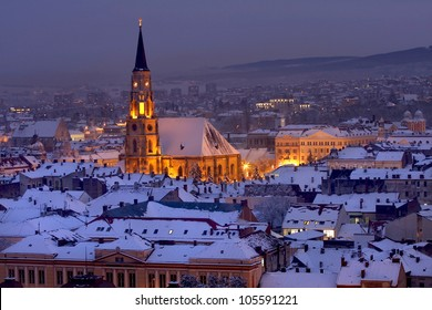 St. Michael's Cathedral, largest Gothic-style church in Cluj, over the city at night, Transylvania, Romania