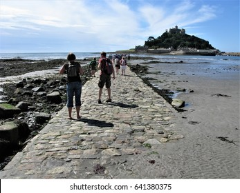 St. Michael's Mount Cornwall UK tourists on causeway