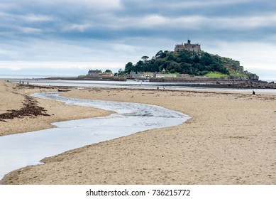St Michael's Mount is a famous island just off the coast of Cornwall at Marazion. The island is accessed via a man-made causeway of granite setts, passable between mid-tide and low water.