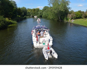ST NEOTS, CAMBRIDGESHIRE, ENGLAND - JULY 04, 2015: Cabin Cruisers on the river Ouse at St Neots.