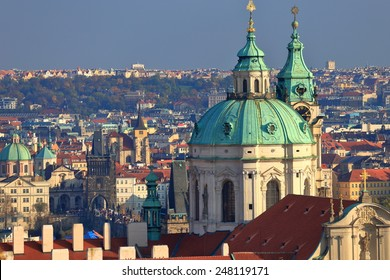 St Nicholas Church dome above orange roof tops of Mala Strana, Prague, Czech Republic