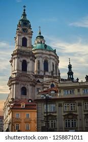 St. Nicholas Church in Prague. Kostel sv. Mikulase. Cathedral in old town. Sunset