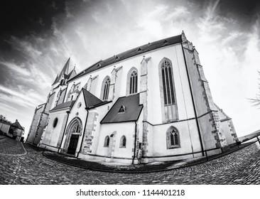 St. Nicholas' Deanery church, Znojmo, southern Moravia, Czech republic. Religious architecture. Travel destination. Fish eye photo. Black and white photo.