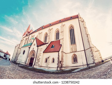 St. Nicholas' Deanery church, Znojmo, southern Moravia, Czech republic. Religious architecture. Travel destination. Fish eye photo. Red photo filter.