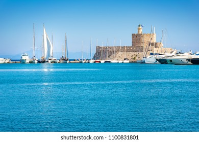 St. Nicoaus fortress with lighthouse in Mandraki harbor in City of Rhodes (Rhodes, Greece)