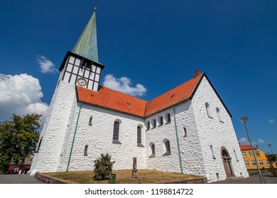 St Nicolas' Church in Ronne, Denmark.St Nicolas' Church with its distinctive tower is the parish church of Ronne on the island of Bornholm in Denmark.