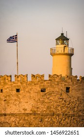 St. Nicolas fortress and Greek flag in Rhodes, Lighthouse in close up