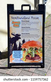 St. John's, NL, Canada - August 11, 2018:  Sign for Moose meat products outside Jungle Jim's Bar and Eatery a Newfoundland based restaurant where  moose are plentiful.