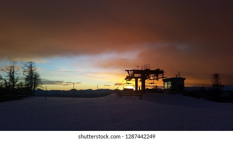 St. Oswald, Austria, Carinthia - December 9, 2018: Captured the silhouette of a lift station on the top of a mountain in St. Oswald, Austria, Carinthia, in the sunset.during a hiking.