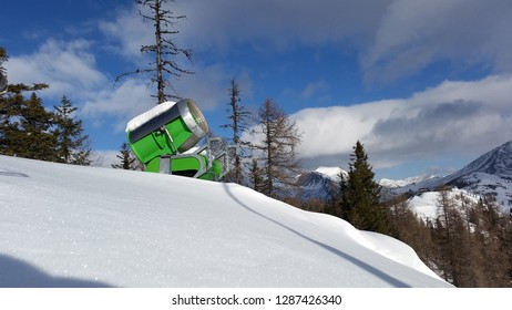 St. Oswald, Austria, Carinthia - January 17, 2019: A green snow cannon captured in the mountains of St. Oswald, Austria during a ski day.