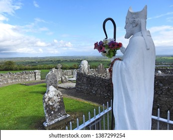 St Patrick on the Hill of Slane with panoramic views of the Irish countryside in the background.